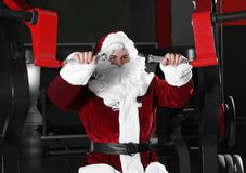 Free Young Santa Claus Training In Gym Royalty Free Stock Photos - 160575448