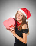 Young santa with giftbox on white Stock Images