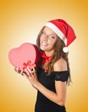 The young santa with giftbox on white Stock Photos