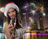 Young Santa girl with champagne glass Stock Photo
