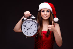 The young santa girl in christmas concept isolated on black Stock Photos