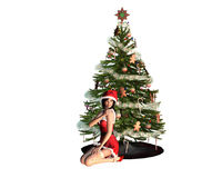 Young Santa Girl close to a Christmas Tree Royalty Free Stock Images