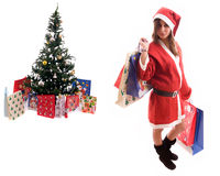 Young Santa Girl close to a Christmas Tree. Isolated over white Royalty Free Stock Images