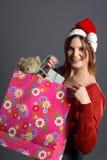 Young santa girl shopping Royalty Free Stock Image