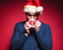 Young santa man drinking a hot tea Stock Images