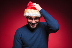 Young santa man scratching his head Stock Images