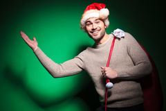 Young santa man is welcoming you with a greeting Stock Photography