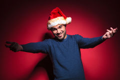 Young santa man welcoming you Stock Photography