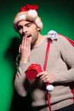 Young santa man is yawning Royalty Free Stock Photos