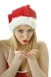 Young santa woman blowing kisses Royalty Free Stock Photography