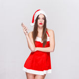 Young santa woman holding cellphone Stock Photography