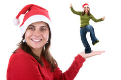 Young santa woman holding a funny small person Stock Image