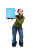 Young santa woman holding giant blue present box Royalty Free Stock Photo