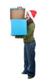 Young santa woman holding giant blue present box Stock Images
