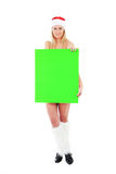 Young Santa Woman Holding Green Blank Banner Stock Photo