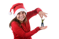 Young santa woman holding small funny person Stock Photo