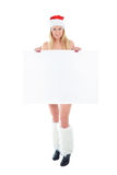 Young Santa woman holding white blank banner Stock Photography