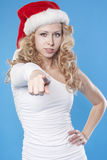 Young Santa woman pointing at you Stock Image