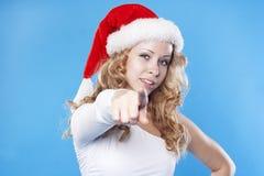 Young Santa woman pointing at you Stock Photo
