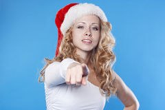 Young Santa woman pointing at you Royalty Free Stock Photos