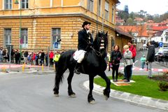 Young sat on the horse in downtown Brasov Stock Photo