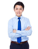 Young satisfied businessman with his arms crossed Royalty Free Stock Image