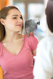 Young  satisfied girl listening diagnosis of veterinarian in vet Royalty Free Stock Images