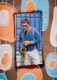 Young saxophonist plays on her sax with bright emotions in the s Stock Photo