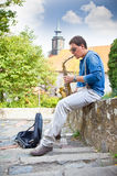 Young saxophonist plays on her sax with bright emotions in the s Royalty Free Stock Images