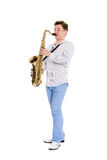 Young saxophonist plays the saxophone Royalty Free Stock Photos