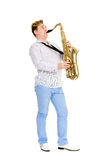 Young saxophonist plays the saxophone Royalty Free Stock Photo