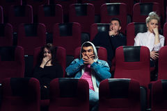 Young scared adults watching horror movie Stock Photography