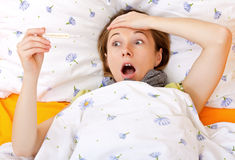 Young scared  sick woman with thermometer Royalty Free Stock Photography