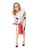 Young scared woman with a fire extinguisher Stock Photos