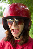 Young scared woman in motorcycle helmet. And glasses stock image