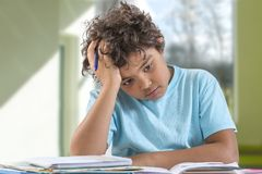 Young school boy having trouble with his homework stock photos