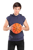 Young school boy holding a basketball Stock Image