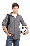 Young school boy holding a football Royalty Free Stock Photo