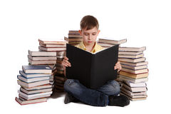 Young school boy reading books Stock Image