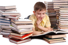 Young school boy reading books Stock Photos