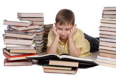 Young school boy reading books Royalty Free Stock Photography