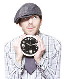 Young School Boy Watching Time While Holding Clock. Young School Student Watching Time While Holding Clock In A Back To School Concept Over White Stock Photography