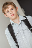 Young school boy wearing a backpack, tilted view Royalty Free Stock Image