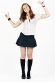 Young school girl dancing Stock Photo