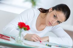 Young school girl drawing pictures at home royalty free stock image