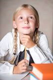 Young school girl dreaming while lesson Royalty Free Stock Photos