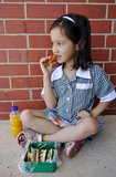 Young School Girl Eating Her Lunch. Royalty Free Stock Photography