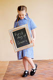 A young school girl on the first day off school royalty free stock photo