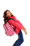 Young school girl with heavy backpack Royalty Free Stock Photo