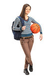 Young school girl holding a basketball Royalty Free Stock Images